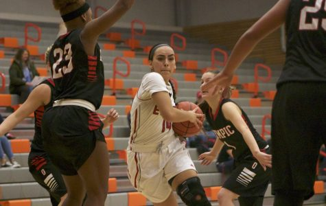 Chibuogwu's Dominant Scoring Output Secures Win for Trojans