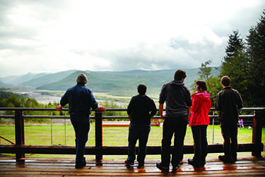 """Professor Steve Grupp and students from """"Project Mayhem"""" take in the view at one of their stops along a field trip showcasing Mount St Helens and Mount Rainier and various natural disasters revolving around them."""