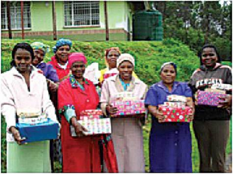 Caretakers holding their Christmas presents; for some it was the first Christmas gift they had ever received.