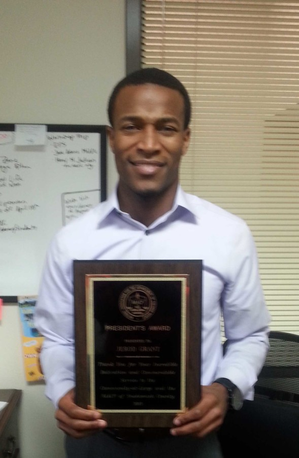 Jerod+Grant+with+the+NAACP+President+award+in+his+office+at+the+Outreach+and+Diversity+Center+oer+at+Parks+and+Student+Union.