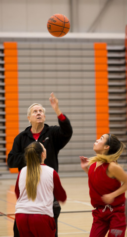 Coach Chet Hovde throwing up the jump ball for his players, during a 5 on 5 drill at practice on Oct 26 2015.
