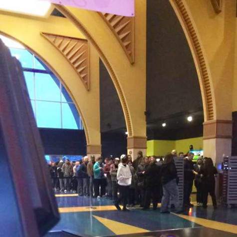 Employees of the Alderwood theater's view of their own doom. Hundreds of people wait for the first showing of Star Wars.