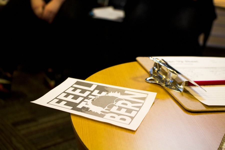 A 'Feel The Bern' flyer lays on the table at the first meeting of the club. Students introduce themselves with ease knowing they all share one thing in common: supporting Bernie Sanders.