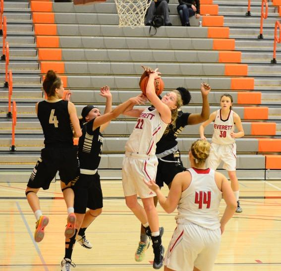 Lily Hilderbrand taking a hard foul on the way to the rim being attacked by several players against Peninsula at the Walt Price Student Fitness Center.