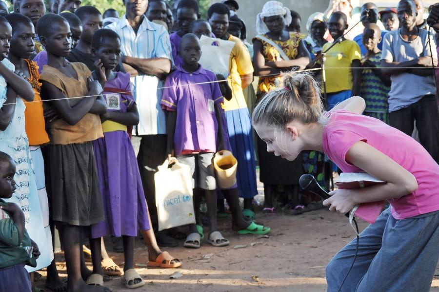Alyssa Thompson tells a parable to a crowd in South Sudan. The translator is not pictured but was  present. Five minutes after the photo was taken, she prayed with a group of 20 people.
