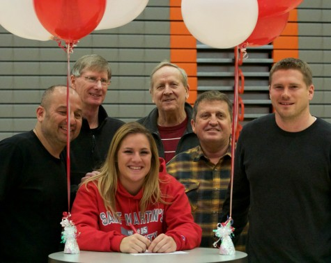 Allison with soccer coach Geoff Kittles (far right) and basketball coach Chet Hovde (in the middle) all gathered together for a picture after the signing on Wednesday, Feb. 3. Also on hand was Athletic Director Larry Walker in the photo.