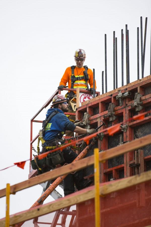 Two construction workers working on the new EvCC student housing building on Jan. 28, 2016