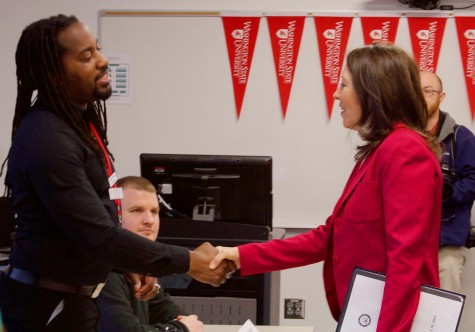 Sen. Maria Cantwell shakes hands with student body president Azrael Howell