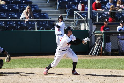 Knocking the ball deep in the outfield, Jake Nelson watches the ball leave his bat against Shoreline Community College.