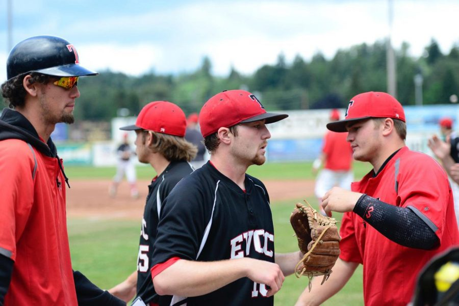 EvCC+pitching+coach+JoJo+Howie%2C%28far+left%29+congratulating+catcher+Tate+Budnick+who+pitched+for+the+Trojans+against+Lower+Columbia+Community+College+in+the+NWAC+Championships.
