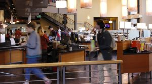 The Parks Café's order of operations filled with students buying and eating food.