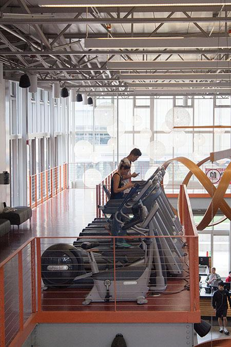 Two people are using the treadmills on the second floor of the Fitness Center. Women were playing basketball in the gym on Oct. 3 but all other areas were open for use.
