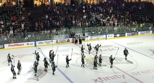 Everett Silvertips players celebrate after a 3-1 victory in their home opener against the Vancouver Giants on September, 24th 2016 at Xfinity Arena.