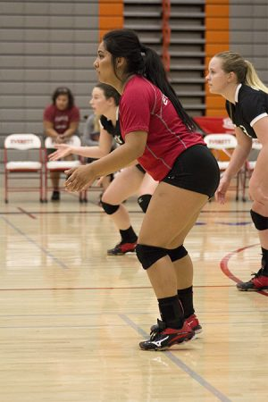 Mia Due, Everett's defensive specialist, awaits an oncoming offensive attack from shoreline.