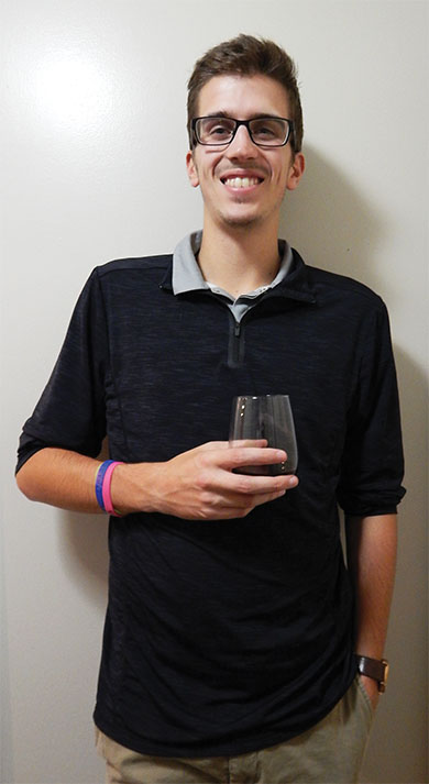 """I always order a glass of water with my drink"" says 24 year-old Darren Crout as he enjoys his wine."