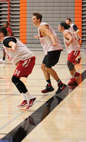 Members of the EvCC Men's basketball team during drills at practice in the Walt Price Student Fitness Center on Oct. 27, 2016. Conner Moffatt is pictured with toilet paper in his nose because of the physical activity exerted during practice, which led to a bloody nose.
