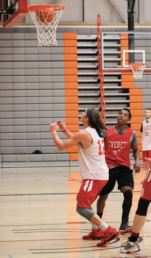 Conner Moffatt looks to grab a rebound during a five on five drill at practice on Oct. 27, 2016. Moffatt is a 6'3 freshman from Spokane who looks to help the Trojans this season.