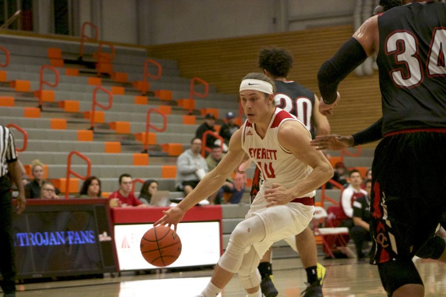Conner Moffatt drives through contact to get to the rim.