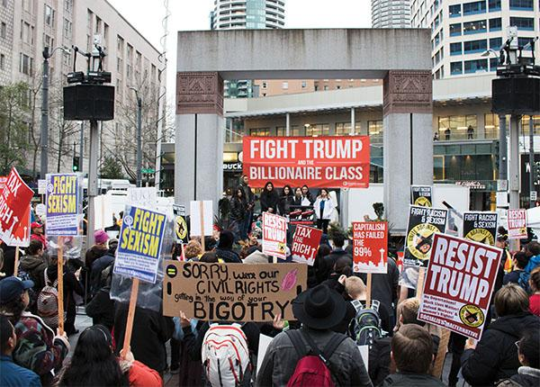 """""""United we stand and united we fall,"""" protesters chanted, calling for Trump to address the nation's environment."""