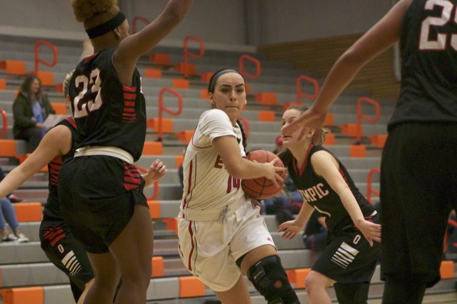 Tyra Lopez cuts through the defense as she drives to the hoop.