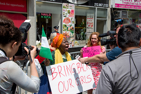 """Activist Delois Blakely protesting next the Nigerian Embassy in New York in 2014. Known as the """"Boko Haram girls,"""" 82 of the kidnapped girls were released May 6. According to BBC news, the parents of the released have not seen their daughters as of press time, and it may be a while. The 21 girls freed last October are still in government custody and weren't allowed home for Christmas."""