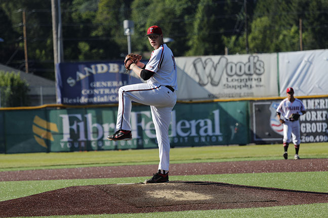 Curtis Bafus delivers a pitch against Lane.