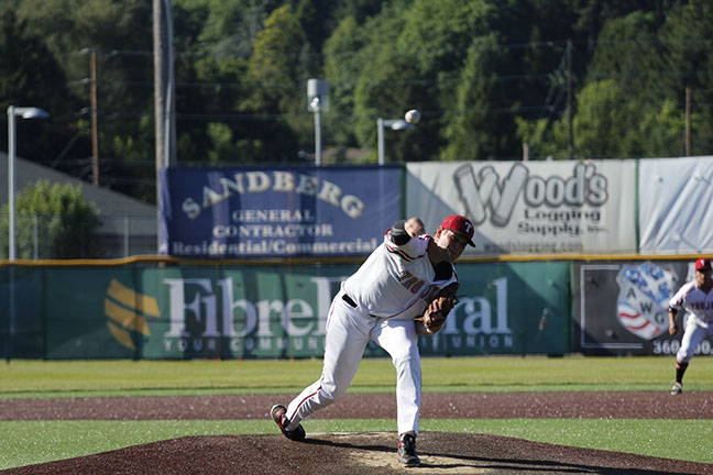 Curtis Bafus throws a pitch during Everetts opening win over Lane.