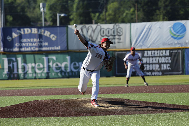 Ryan Sandifer hurls a pitch from the mound during Everetts win over Lane.
