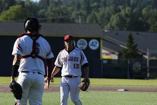Ryan Sandifer and Connor OBrien celebrate after a scoreless inning on defense.