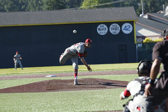 Spencer Steinle delivers a pitch from the mound during Everetts 15-inning win over Tacoma.
