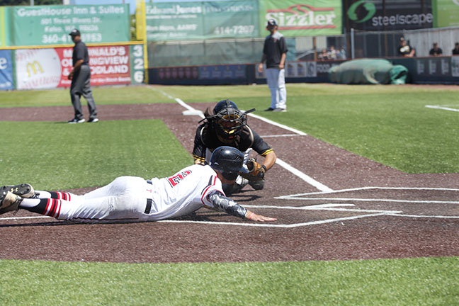 Jaden Yackley slides into home plate during Everetts win over Walla Walla.