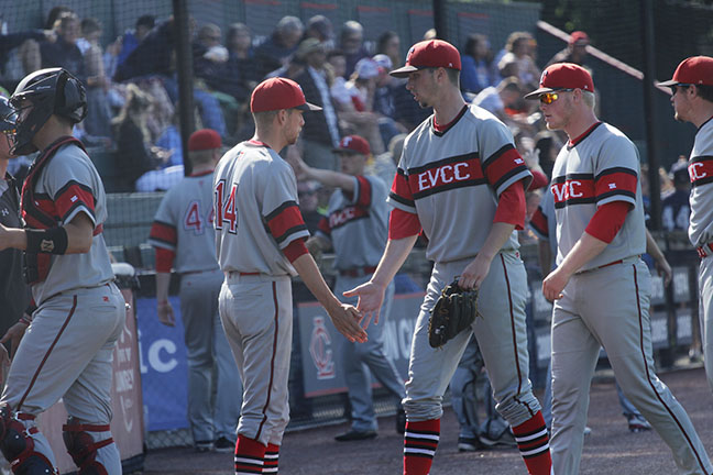 Dalton Chapman heads back to the dugout after an inning on the mound in the championship game.