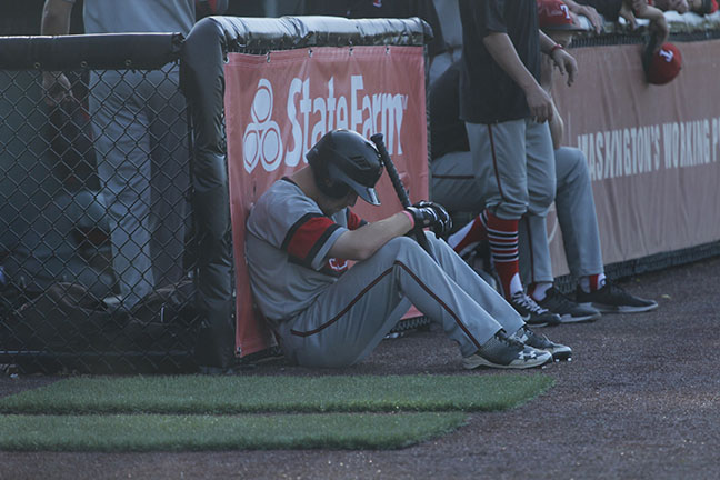 Jaden Yackley sits near the dugout as Lower Columbia celebrates their championship win.
