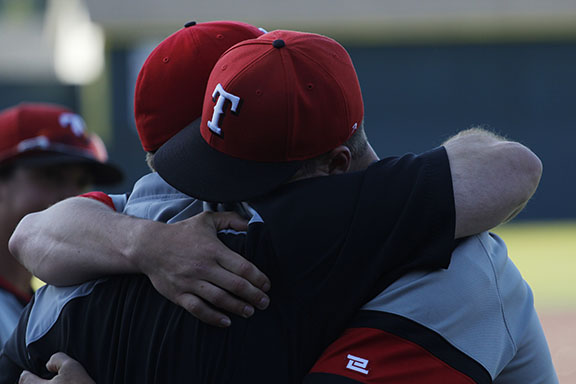 Dalton Chapman and Coach Lacey embrace after falling to Lower Columbia in the championship.