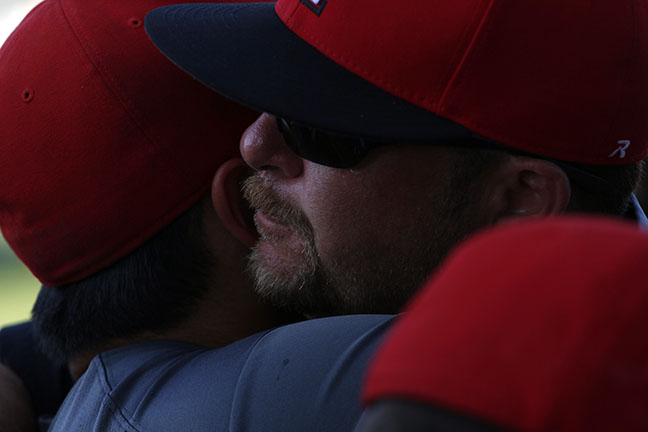 Head Coach Levi Lacey shares an embrace with one of his players after an emotional end to the tournament.