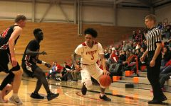 Tempers Flare as Jackson and Brown Jr. Lead Trojans to Victory