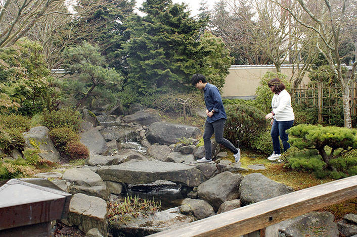 Kuniaki Moribe and Mirei Maejima, two international students from Japan, exploring the Nishiyama Japanese Garden. With parts directly shipped from Japan, the Nishiyama Japanese Garden evokes authenticity in a place far from home.