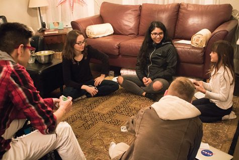 EvCC students and SWE Club members, Hanna Wells and Hilda Pacheco, with the club advisors' daughter, Zandrea Washburn. The club members gather at the Washburn home to play games and socialize.