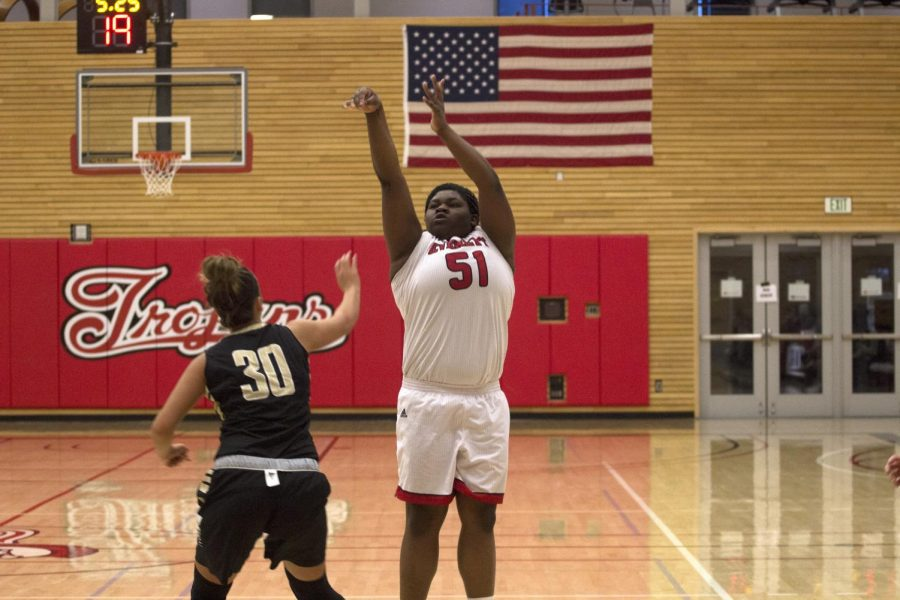 Uju Chibuogwu pulls up for a three from the wing. Chibuogwu was instrumental in the Trojans win as the sophomore scored 31 points in the win.