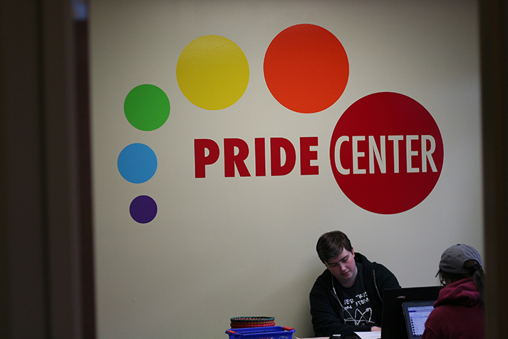 """Bright colors decorate the walls of the Pride Center and create a comfortable atmosphere for those who are a a part of the gay community. In the little room located in Parks Student Union, Linda McCallister, 18, studies with her friend during lunch. McCallister is listening to Foster the People because she """"enjoy(s) this genre of music and it's a part of a larger playlist (she) is cycling through at the moment."""" She also listens to Magic Giant, Maroon 5 and Jessie J."""