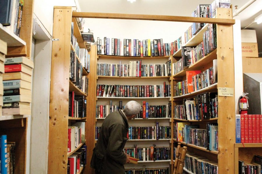 ▶ A customer at the 3rd Street Book Exchange browsing  the store's horror section.