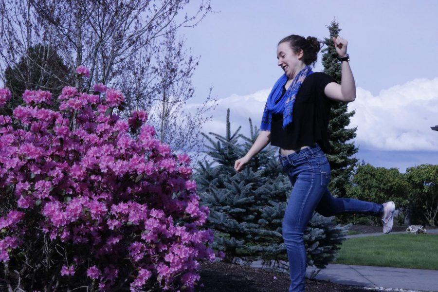 Morgan Crosby angrily kicking purple rhododendrons.