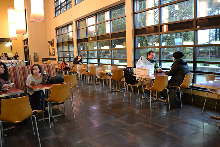 """Thomas Sams and Mandi Stelter (pictured, right) meet every Thursday in Parks Café to have breakfast and work on projects for their communications class. Today, Thomas brought three dozen heart-shaped doughnuts.  What had been intended as a romantic Valentine's gesture for his wife the previous evening – 1 dozen for every year of their marriage – are now up for grabs.  He shook his head as he said, """"She actually told me, 'These donuts are so bad they are not worth the carbs.'"""" He continues: """"I wanted to surprise her.  I tried – I hate holidays!""""  Sams adds he """"drove all the way to Shoreline"""" to buy the donuts; """"It came from the heart.""""  He shrugs and offers, """"Want one?"""""""