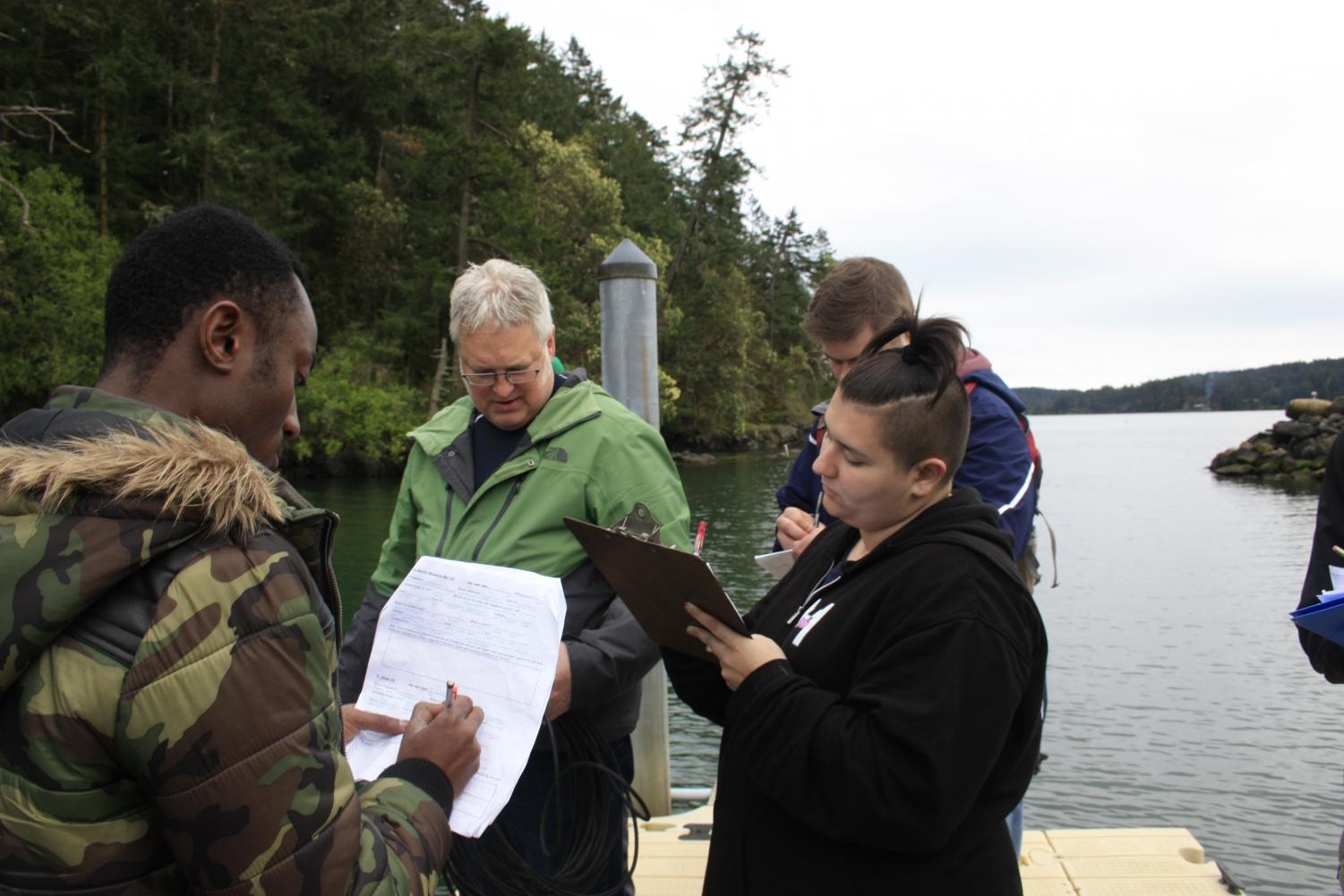 Students conduct lab work on a field trip to Orcas Island for Geography 205