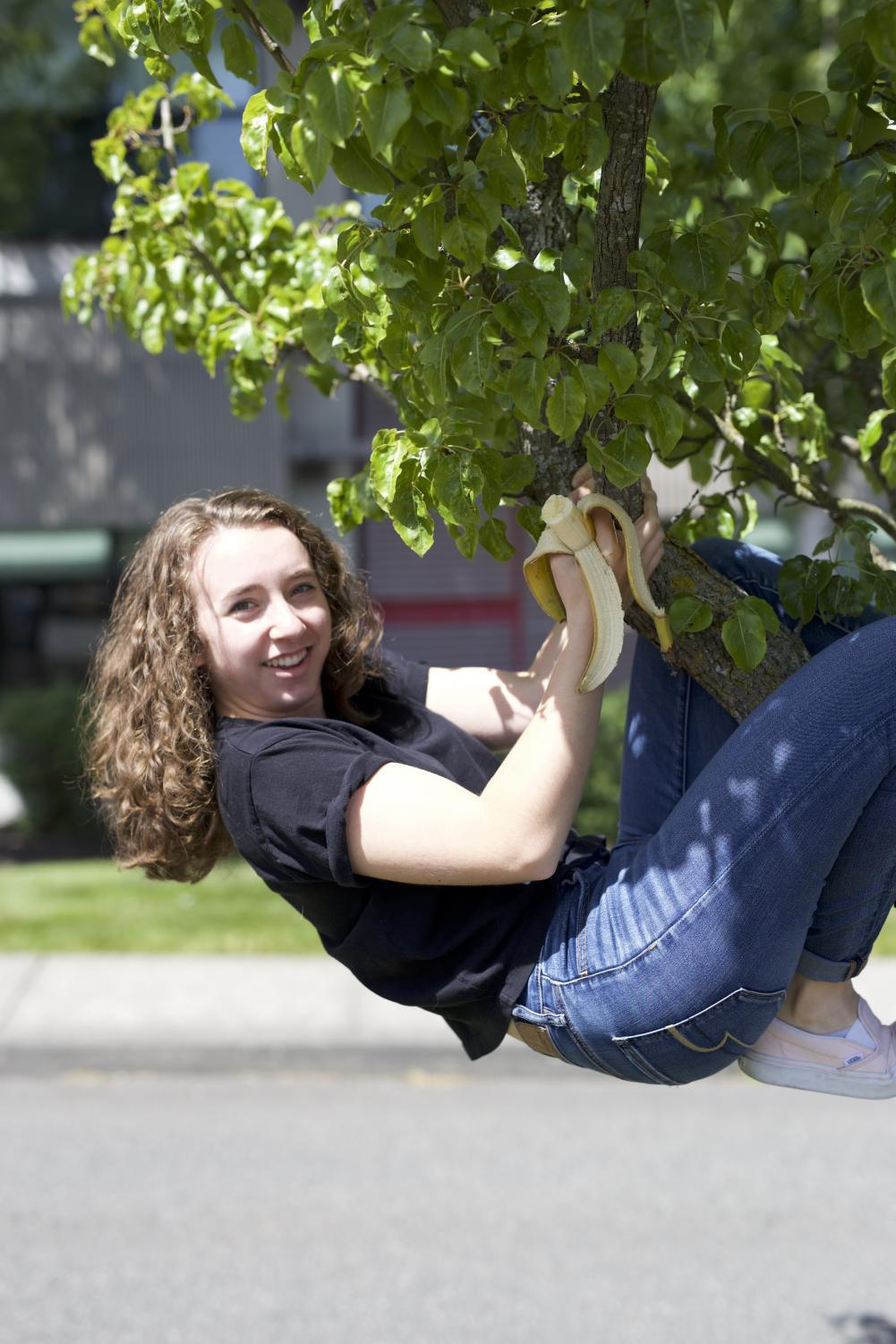 Morgan Crosby hangs from a tree with her beloved banana.