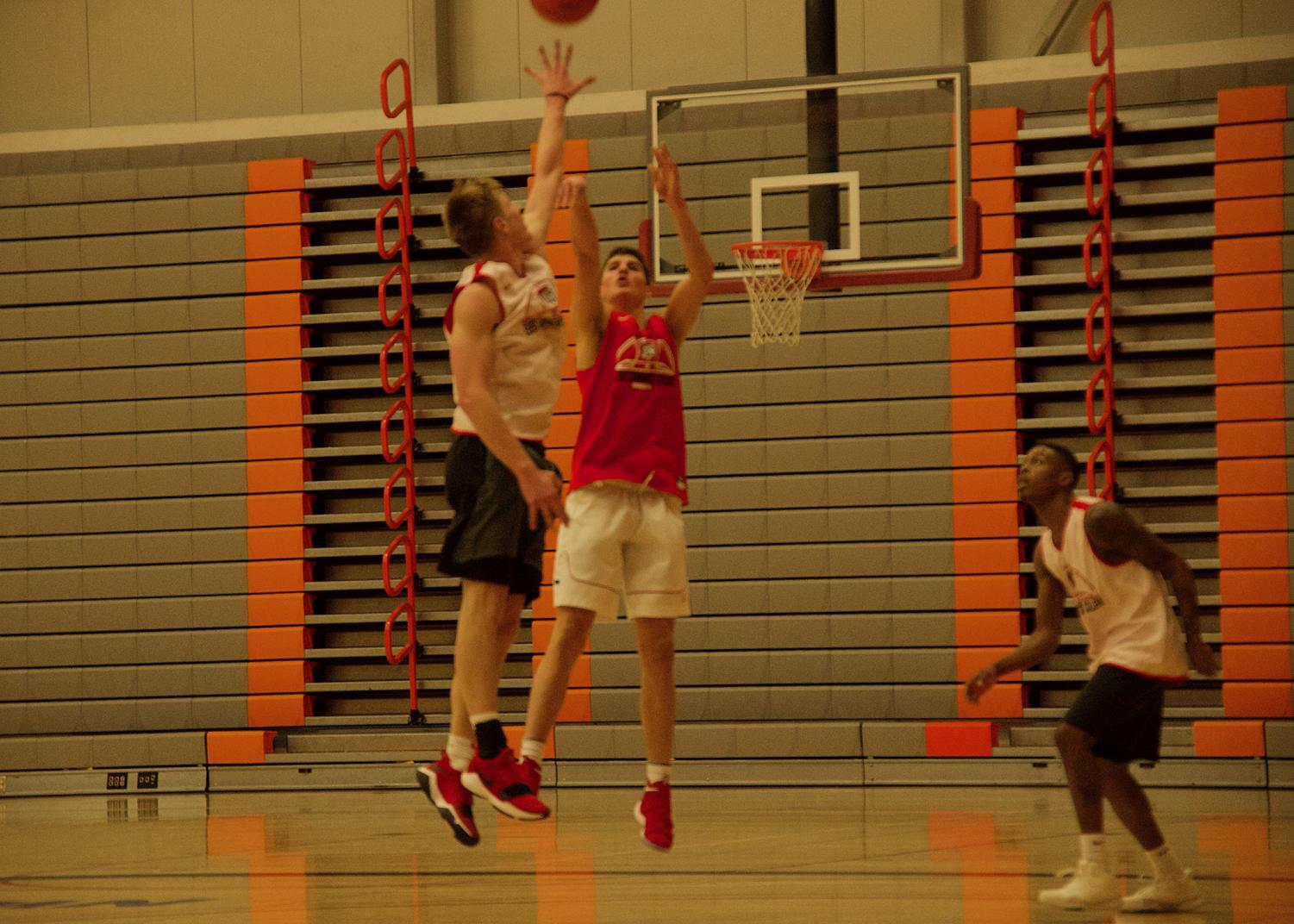Bolles (middle, red) launches a shot during practice.