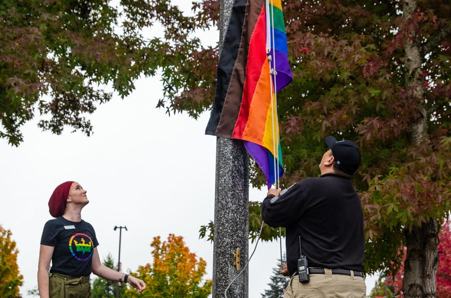 Autumn+Spangler%2C+Pride+Center+Coordinator%2C+looks+on+as+the+rainbow+flag+is+raised+as+part+of+Pride+Week+events.