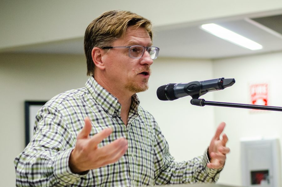 """Mike VanQuickenborne, president of the teachers' union, presents their """"vote of no confidence in the majority of the Board of Trustees"""" on Nov. 6."""