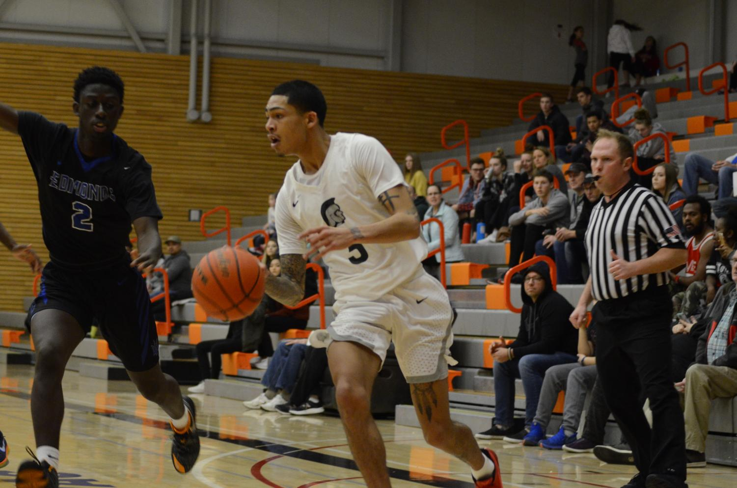 Trojan%E2%80%99s+star+Sophomore+guard+Markeith+Brown+Jr.+dribble+drives%2C+gaining+the+inside+position+on+Edmonds%E2%80%99+Forward+Muhammed+Kolly+in+a+92-76+victorious+effort+Saturday+night.+
