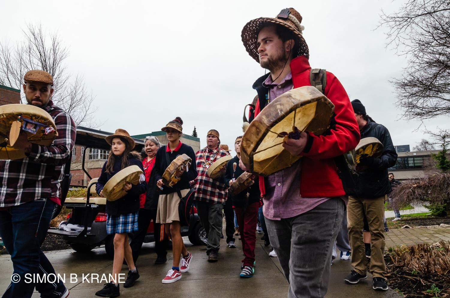 Josh Fryberg (left) and Bradley Althoff (right) play drums during the Indigenous Peoples March on Jan. 17